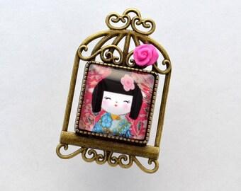 """""""Kokeshi"""" pattern glass cabochon brooch"""