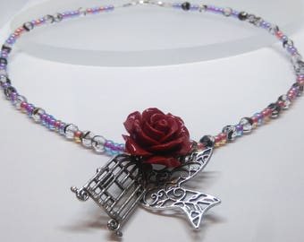 Charm and glass beaded necklace