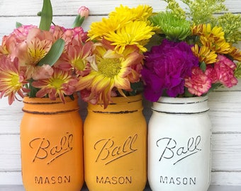 Tangerine orange, Saffron yellow, Ivory painted and distressed mason jars.  Thanksgiving decor, fall colors, autumn jars, custom colors too!