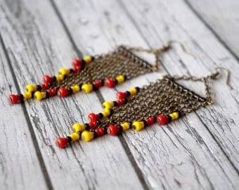 Long earrings red, black, yellow.