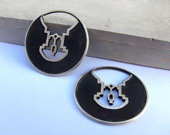 oxidized silver earrings. round earrings. silver hoops