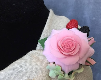 Brooches with rose and berries made from polymeric clay