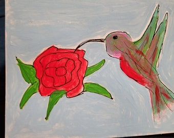 Hummingbird with rose