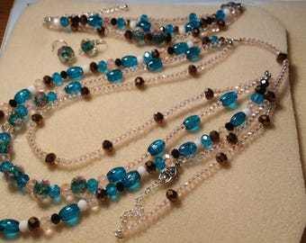 Crystals, crystals,this is a 3 strand crystal jewelry set 3 pieces