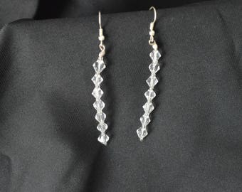 Earrings with white Swarowsky resin