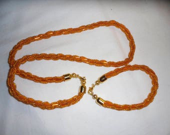 Bracelet and Necklace of orange beads. Handmade. Jewelry for women.