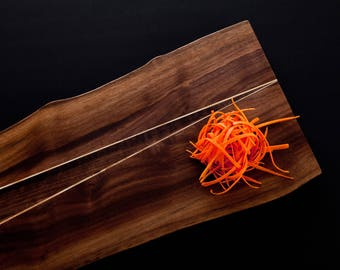 Walnut cutting board with inserts