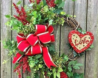 Valentine's Day Crescent Wreath with Red Astilbe, Eucalyptus, Tea, Red and Gold Heart Shaped Love Plaque and a Red Velvet w/Gold Trim Bow