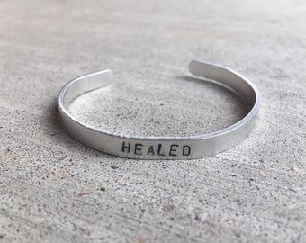 Healed aluminum bangle bracelet
