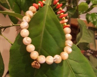 Exclusivist Coral and trochus shell bracelet