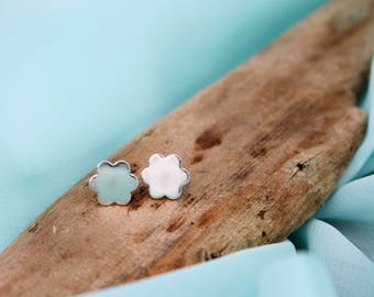 Handmade sterling silver flower stud earrings.