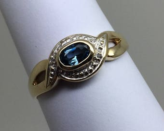 blue topaz 9ct gold ring with diamonds