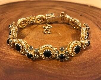 Alice Caviness black bracelet