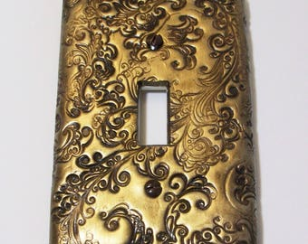 ON SALE was 10.95: Antique gold dots curls and swirls single light switch cover