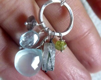 Blue aquamarine cluster necklace with chalcedony, peridot, rutilated quartz and labradorite gemstones on sterling silver open circle pendant