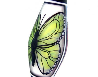 Pink and chartreuse green butterflies on white, Illustration in Glass, handmade lampwork glass bead focal by JC Herrell