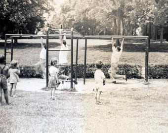 vintage photo 1946 Eerie Strange Unusual Children from Back Watch Men Monkey Bars Playground