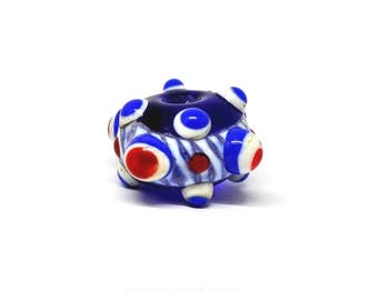 Museum style green red white blue bead