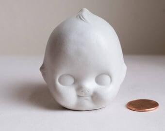 Mini Doll Head
