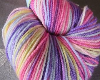 "One Skein Hand Dyed Artisan Adorn Sock Yarn ""Three Irish Girls"" Colorway: MEG Merino Nylon Pinks Purples Pastel Yellow Blue"