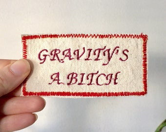 Gravity, the bummer. Handmade Embroidered Canvas Patch. One of a kind