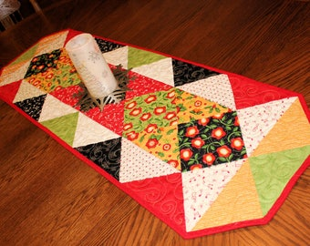 Quilted Table Runner - Mary Englebreit Christmas Carolers Bright Table Topper Quilt, Red, Green Black Centerpiece