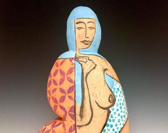 Woman In Blue; Kneeling Toward A Bird Of Peace; Closed Form; Fine Ceramic Arts