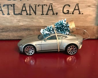 Aston Martin Carrying Christmas Tree Ornament