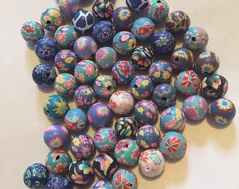 Pack of 59 x 10mm polymer clay round mix of blue themed flower etc beads.