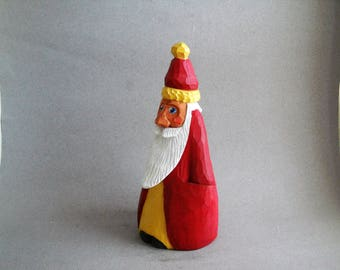 Santa in red and gold robe
