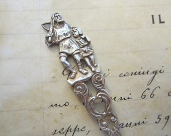 vintage silver plated spoon - man with crossbow walking with child, archer, hunter - demitasse spoon