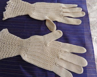 Vintage  crocheted pair of gloves  Ivory color  size small to medium never used.  Tight weave on hands, loose weave on wrist