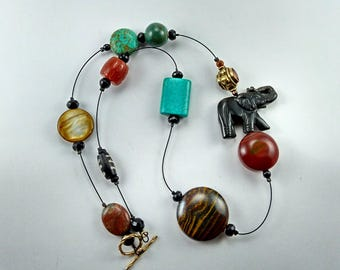 A new Gemstone Floating Necklace With Carved Onyx  Elephant -157A