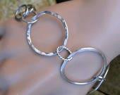 Hand formed sterling silver large hoops bracelet