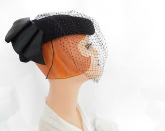 Woman's black hat, vintage tilt with back bow, netting