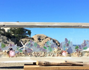 Soft pastel beach glass with shells and sand