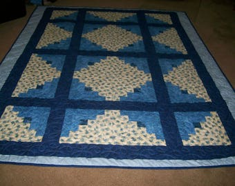 Twin Size Quilt with Blues and Blue Roses made from Log Cabin Blocks