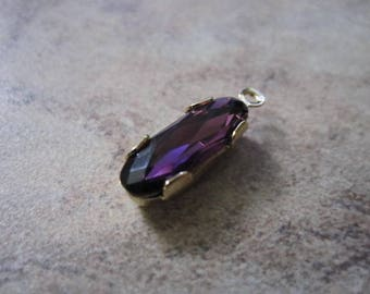 Drop, Swarovski® crystals and gold-plated brass, amethyst, 15x6mm faceted oval. JD166