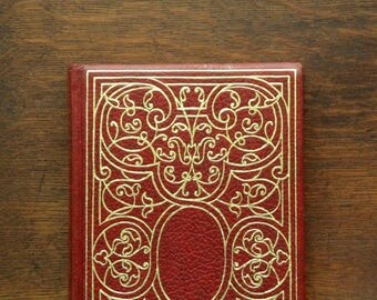Oscar Wilde Stories The Picture of Dorian Gray and others bound in red faux leather.