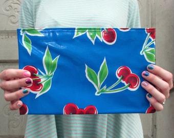 "Cobalt Cherry Print Oilcloth Bag, for a clutch purse or makeup bag. Regular size 10.5"" by 6.25"""