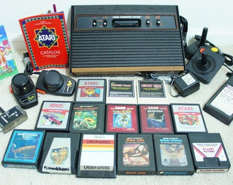 PRISTINE Vintage Atari 2600 console + 2 controllers + 2 Paddle controllers + 1 Video Touch Pad + all cables + 14 games. Complete set, TESTED