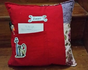 Red and floral purple pocket pillow.