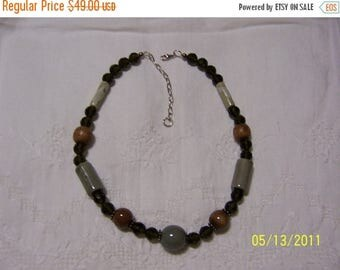 TWICE A YEAR, 25% Off Ceramic and Olive Crystal necklace. sterling