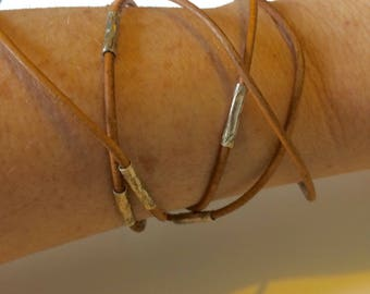 Tan leather wrap bracelet with silver tube beads