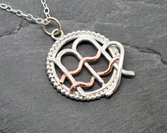 Aquarius Virgo necklace sterling silver and polished copper with beaded edging.