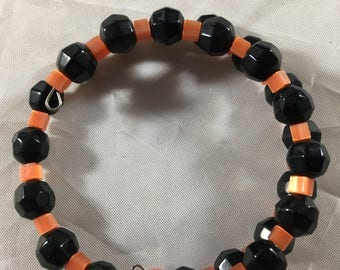 Orange and black beaded bracelet