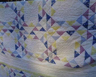 Vintage Hand Sewn Quilted Bed Cover in Vintage Condition in a soft pastel color palette of blue, purple and yellow of a Flower Basket Design