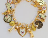Gold French heart charm bracelet, pink white rose guilloche charms, ooh la la, je t'aime, airmail, locket, credit card, Eiffel Tower, pearls