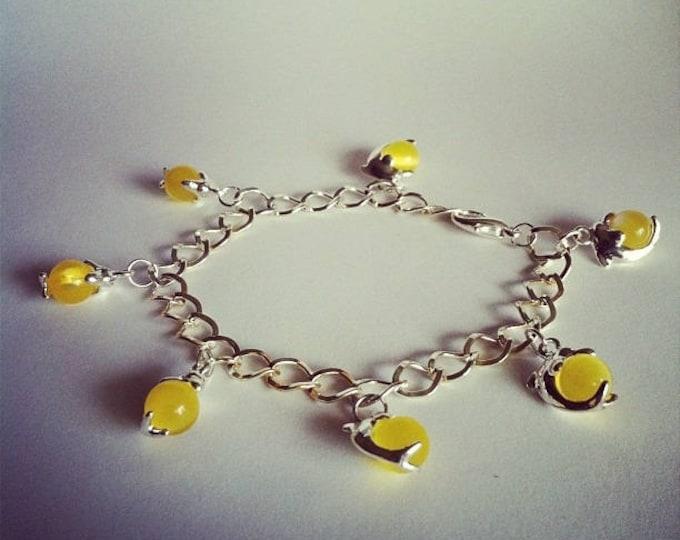 Dolphins charm bracelet yellow glass beads
