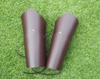 black or brown layered vambraces